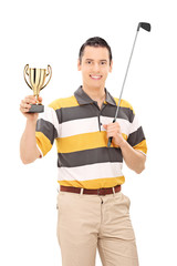 Golfer holding a trophy and golf club