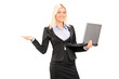 Businesswoman holding a laptop and gesturing