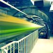 train fast moving at subway station