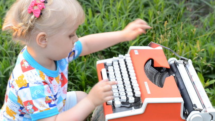 Retro Typewriter Machine in use. Little Girl Writer Printing in