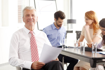 Senior businessman sitting at meeting