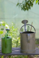 Watering cans on a table