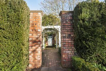 Garden entrance, through pillars, down path to gate.