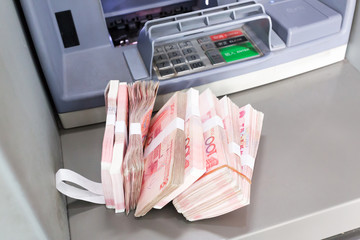 withdrawal a lot of CNY from the ATM