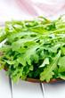 fresh arugula leaves on plate