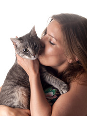 Beautiful brunette kissing and petting her cute grey cat