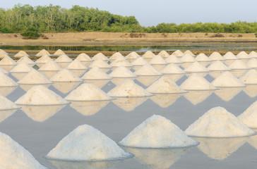 Heap of sea salt in evaporation pond, Thailand
