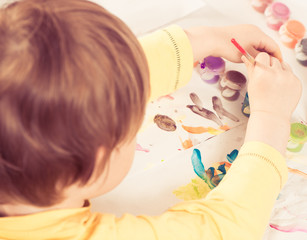 boy drawing with paint