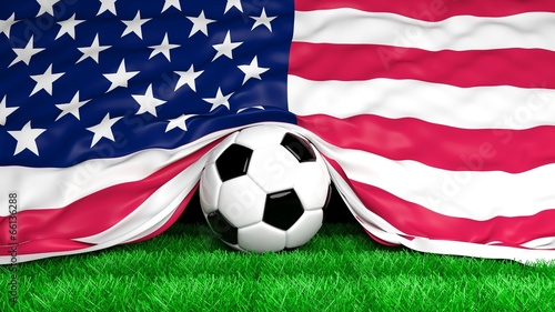 Soccer ball with Usa flag on football field closeup