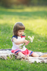 Little girl holding flowers