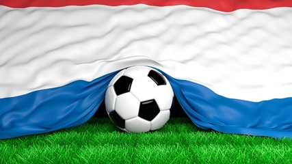 Soccer ball with Dutch flag on football field closeup