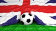 Soccer ball with British flag on football field closeup