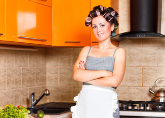 middle-age woman with apron in the kitchen