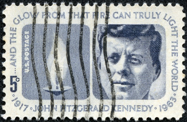 stamp shows Flame and portrait of John Fitzgerald Kennedy