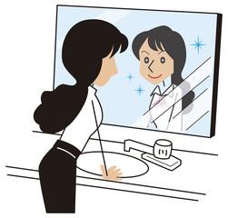 元気な自分を鏡で確認するビジネスウーマン