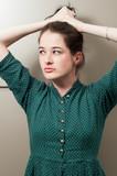 Girl grasping her hair. poster