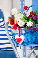 Blue basket with flowers, champagne and plush hearts