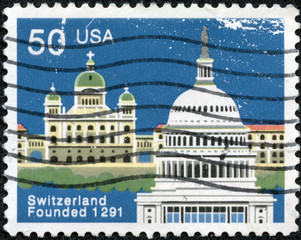stamp shows Federal Palace, Bern and Capitol, Washington