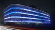 Modern building facade with blue light