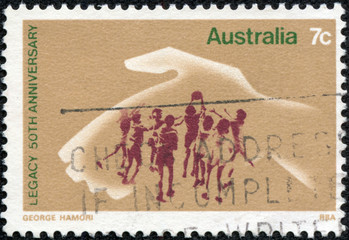 stamp shows Hand Protecting Playing Children