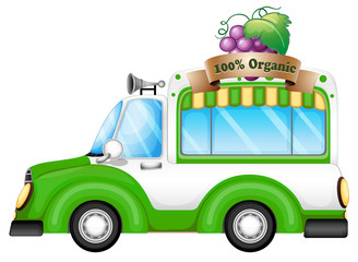 A green vehicle selling organic fruits
