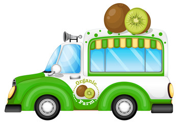 A green vehicle selling kiwi fruits
