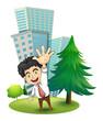 A happy businessman near the pine tree