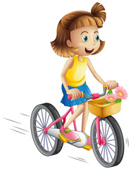 A happy girl riding a bike