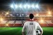 Composite image of usa football player holding ball