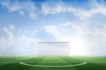 Football pitch under blue sky