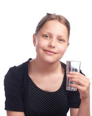teen girl drinking water from glass