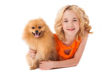 little smiling girl holding her dog