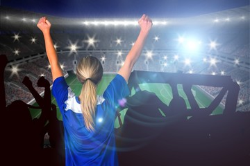 Composite image of cheering football fan in blue