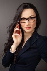 brunette woman wearing jacket talking on the cell phone