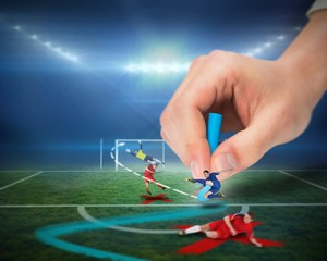 Hand drawing tactics on football pitch during match