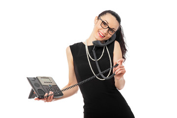 businesswoman in black dress talking on the telephone