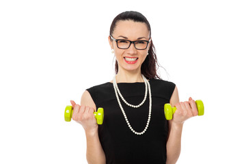 brunette women holding green dumbbells in black dress