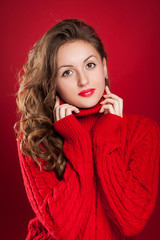 beautiful brunette girl wearing red sweater