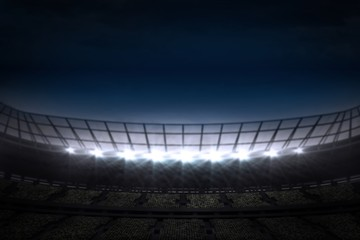 Large football stadium under night sky