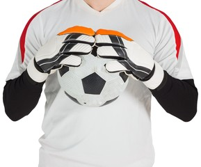 Goalkeeper in white holding ball