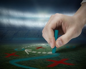 Hand drawing tactics on football pitch