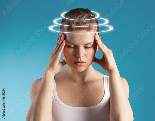 Fototapeta Woman with vertigo. Young patient suffering from dizziness