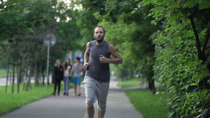Man jogging in city park, super slow motion, shot at 480fps