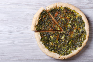 Open pies with herbs, cheese and spinach  top view