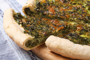 Pie with spinach and soft cheese closeup