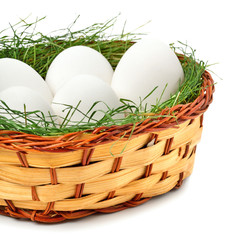eggs with green grass in the basket