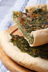 sliced pie with spinach and soft cheese vertical