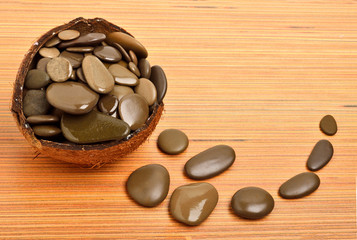 Pebble stones for spa in coconut shell