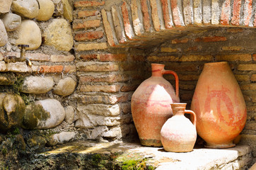 Old clay jugs in the brick and stone place