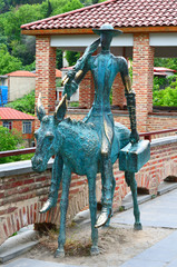 Copper statue of a man on the donkey in Sighnaghi
